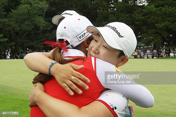 Jiyai Shin of South Korea hugs with Lee BoMee after a winning putt on the 18th green during the final round of the Nichirei Ladies at the Sodegaura...