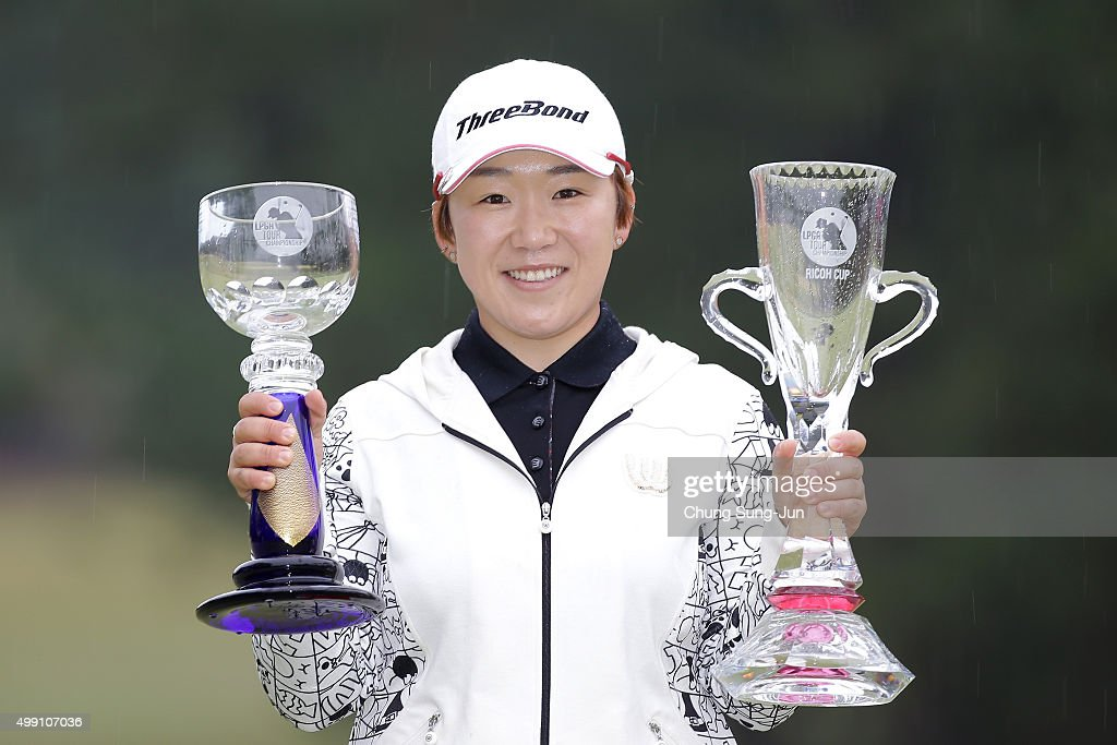 Ji-Yai Shin of South Korea lifts the Championship's trophy (blue) and sponsor's Ricoh Cup trophy (red) during a ceremony following the LPGA Tour Championship Ricoh Cup 2015 at the Miyazaki Country Club on November 29, 2015 in Miyazaki, Japan.