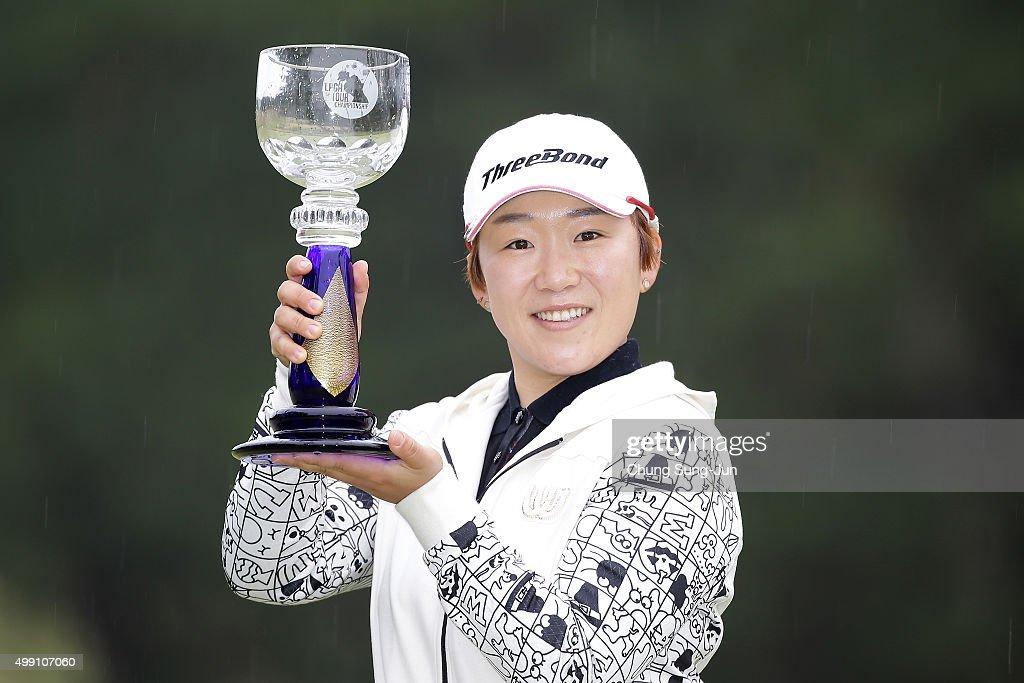 Ji-Yai Shin of South Korea lifts the Championship's trophy during a ceremony following the LPGA Tour Championship Ricoh Cup 2015 at the Miyazaki Country Club on November 29, 2015 in Miyazaki, Japan.