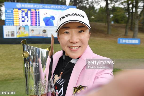 Jiyai Shin of South Korea poses for a simulated selfie with the championship trophy after winning the Daio Paper Elleair Ladies Open 2017 at the...