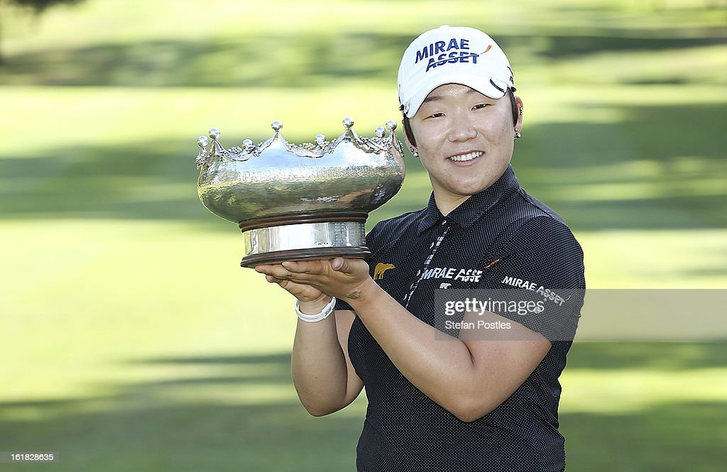 Jiyai Shin of South Korea poses for photographers with the Patricia Bridges Bowl after winning the ISPS Handa Australian Open at Royal Canberra Golf Club on February 17, 2013 in Canberra, Australia.