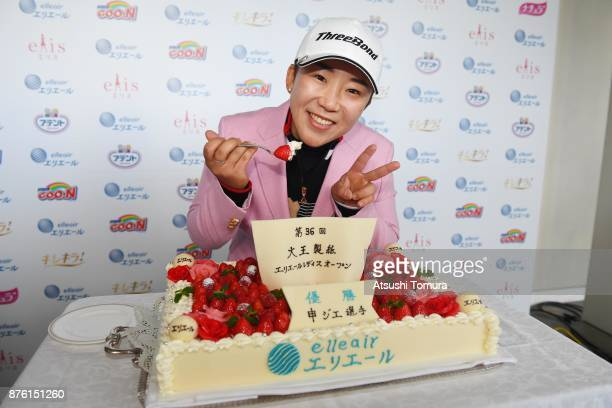 Jiyai Shin of South Korea poses with a cake after winning the Daio Paper Elleair Ladies Open 2017 at the Elleair Golf Club on November 19 2017 in...