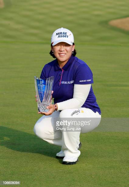 JiYai Shin of South Korea poses with the tournament trophy during the final round of the Mizuno Classic at Kintetsu Kashikojima Country Club on...