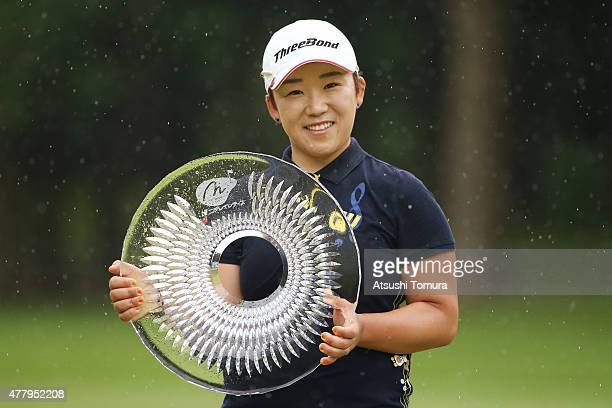 JiYai Shin of South Korea poses with the trophy after winning the Nichirei Ladies at the Sodegaura Country Club Shinsode Course on June 21 2015 in...