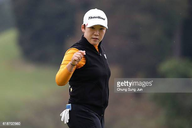 Jiyai Shin of South Korea reacts after a birdie putt on the 18th green during the first round of the Higuchi Hisako Ponta Ladies at the Musashigaoka...