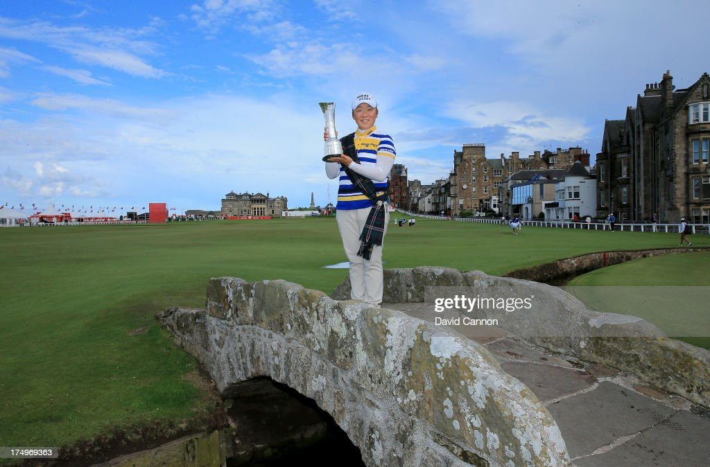 Jiyai Shin of South Korea the 2012 Ricoh Women's British Open Champion poses on the Swilken Bridge on the 18th hole as a preview for the 2013 Ricoh Women's British Open on the Old Course at St Andrews on July 29, 2013 in St Andrews, Scotland.