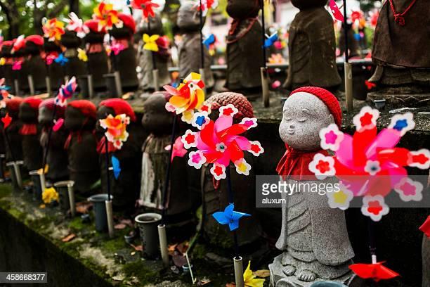 Jizo statues in Zojoji temple Tokyo Japan