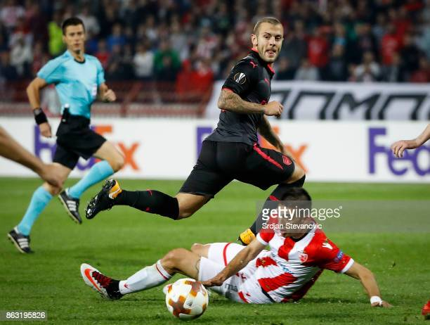 JJack Wilshere of Arsenal in action against Vujadin Savic of Crvena Zvezda during the UEFA Europa League group H match between Crvena Zvezda and...