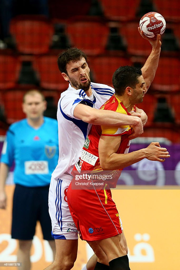 Jkov Gojun of Croatia defends against <a gi-track='captionPersonalityLinkClicked' href=/galleries/search?phrase=Kiril+Lazarov&family=editorial&specificpeople=3239733 ng-click='$event.stopPropagation()'>Kiril Lazarov</a> of Macedonia during the IHF Men's Handball World Championship group B match between Macedonia and Croatia at Duhail Handball Sports Hall on January 21, 2015 in Doha, Qatar.