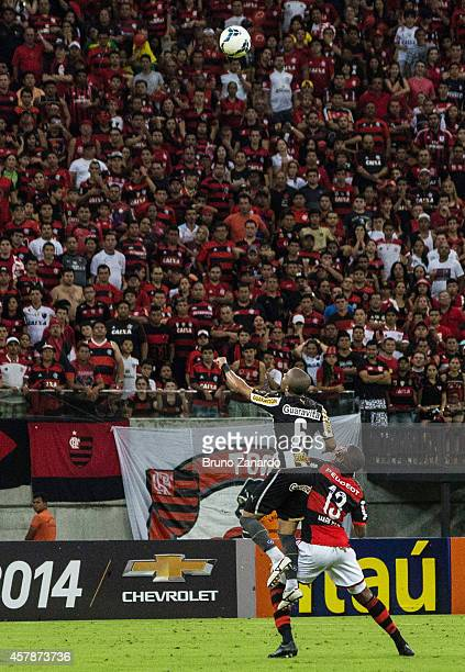 Jnior Cesar of Botafogo goes to ground after a challenge by Marcelo of Flamengo during the Brasileirao Series A 2014 match between Flamengo and...