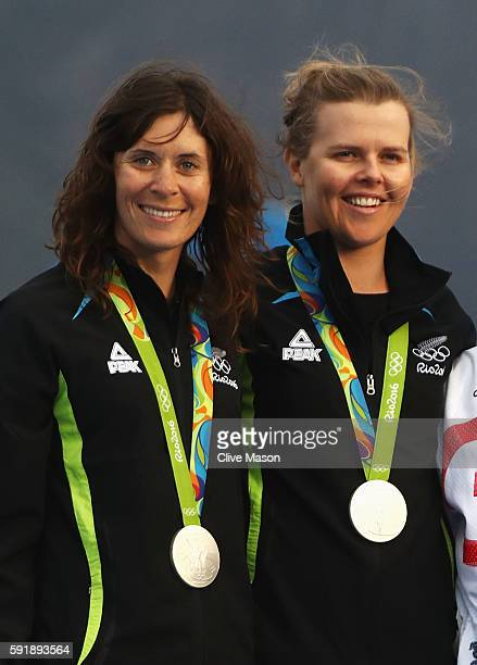 Jo Aleh of New Zealand and Polly Powrie of New Zealand celebrate winning the silver medal in the Women's 470 class at the Marina da Gloria on Day 13...