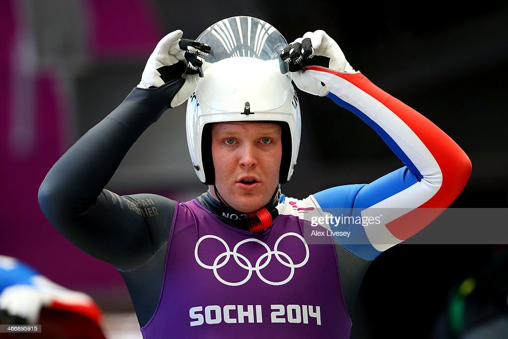 Jo Alexander Koppang of Norway adjusts his helmet during a men's luge training session ahead of the Sochi 2014 Winter Olympics at the Sanki Sliding Center on February 5, 2014 in Sochi, Russia.