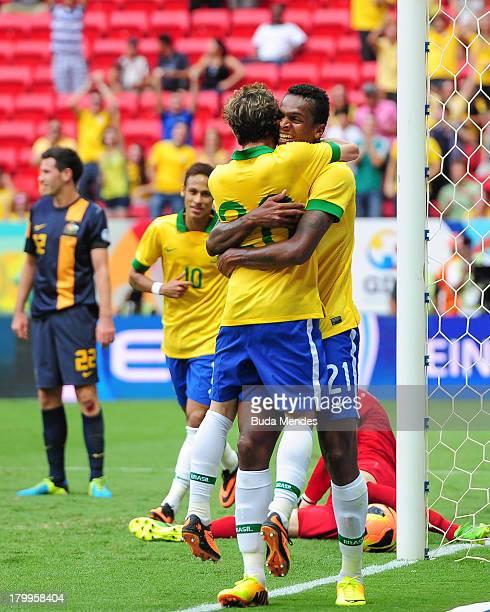 Jo and Bernard of Brazil celebrate a scored goal of Jo against Australia during the International friendly between Brazil and Australia at Mane...