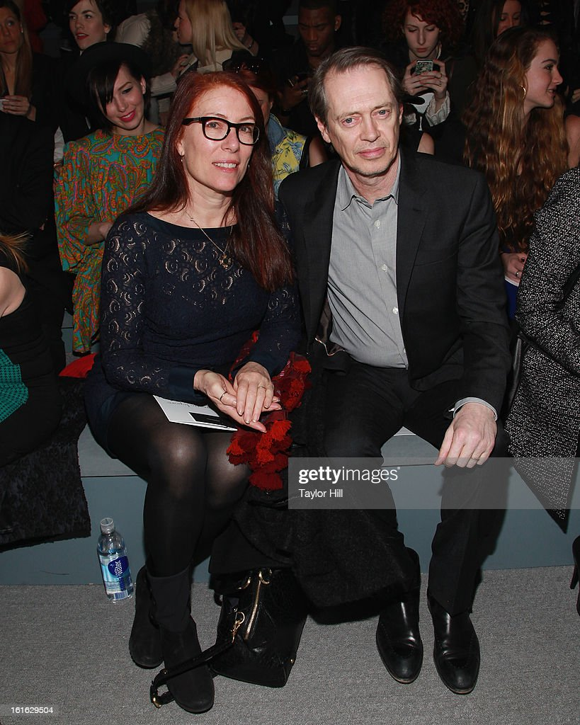 Jo Andres and Steve Buscemi attend the Nanette Lepore Fall 2013 Mercedes-Benz Fashion Show at The Stage at Lincoln Center on February 13, 2013 in New York City.