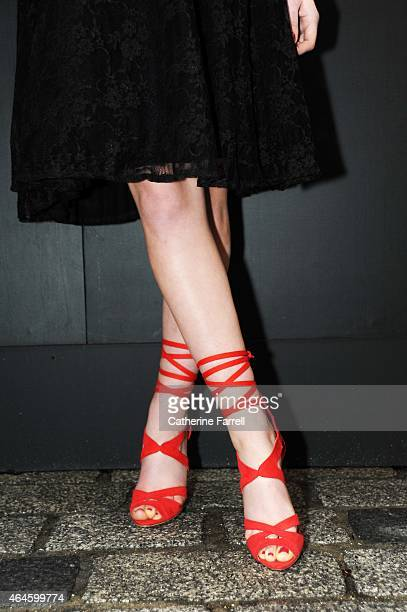 Jo Archibold model covering London fashion week for Xpose magazine wearing geranium red wedge sandals with spagetti strap ties from New Look to...