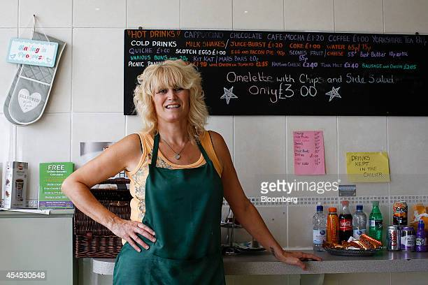 Jo Conlin coowner of The Picnic Basket sandwich shop poses for a photograph in Hull UK on Friday Aug 22 2014 Hull with a population of about 250 has...