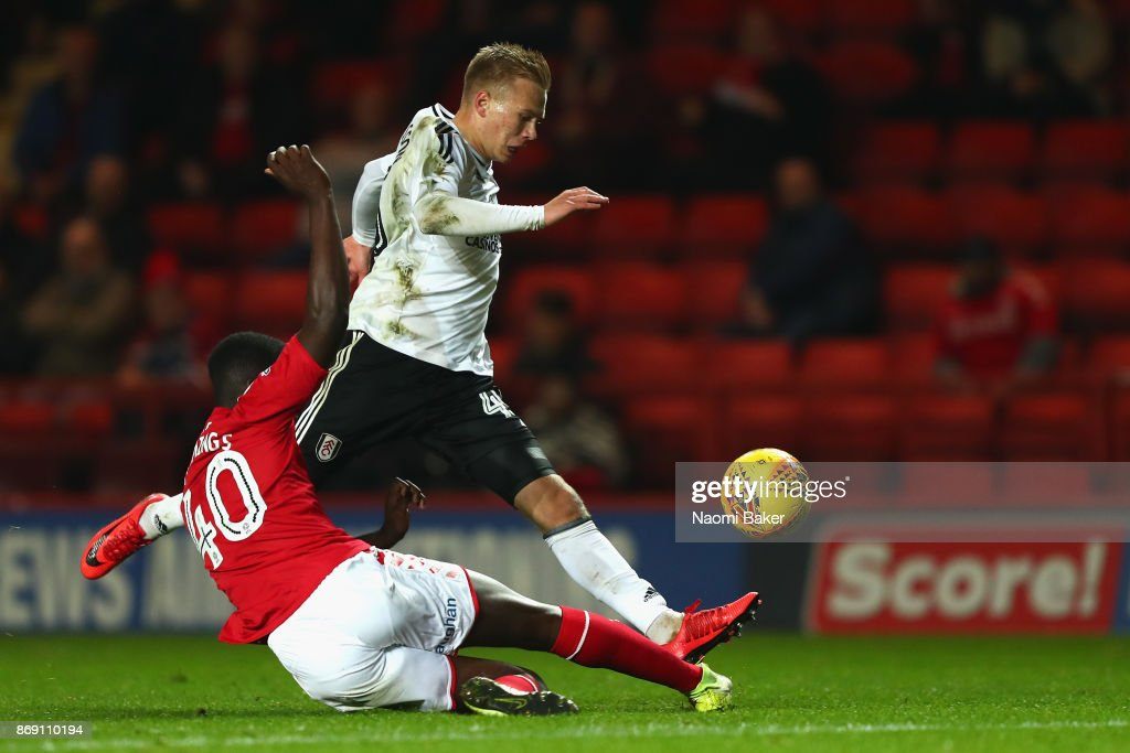Jo Cummings of Charlton tackles Jon Dagur Thorsteinsson of Fulham during the Checkatrade Trophy match between Charlton and Fulham at The Valley on November 1, 2017 in London, England.