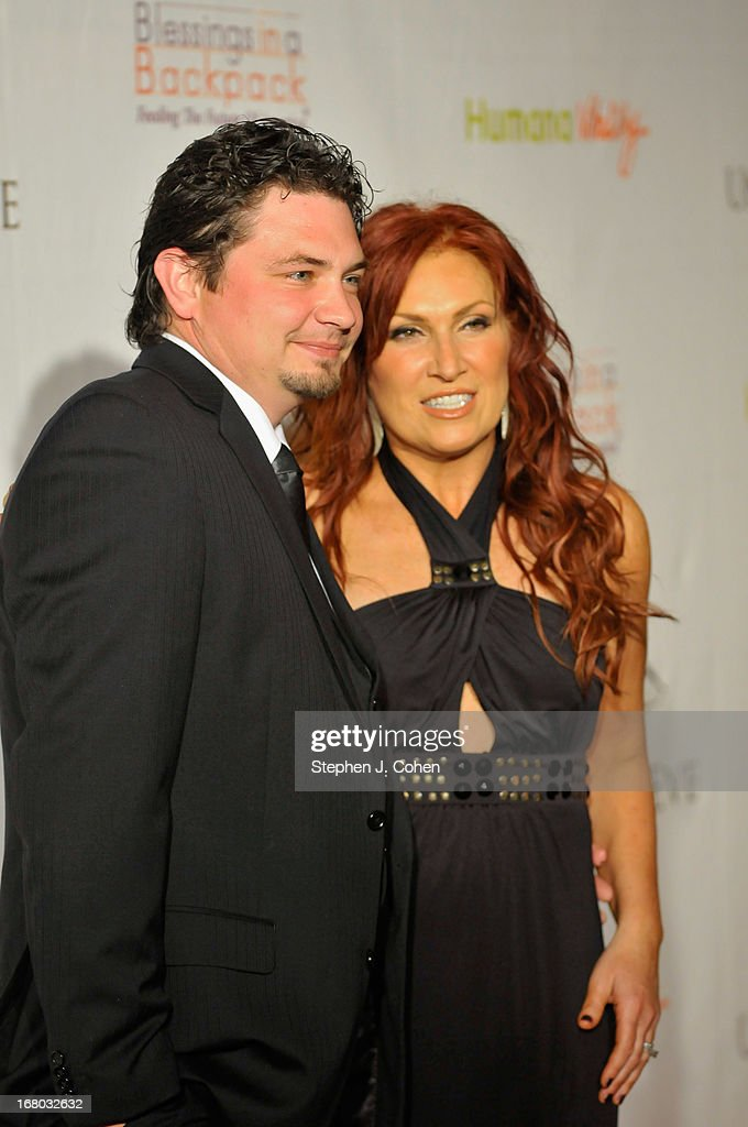<a gi-track='captionPersonalityLinkClicked' href=/galleries/search?phrase=Jo+Dee+Messina&family=editorial&specificpeople=208168 ng-click='$event.stopPropagation()'>Jo Dee Messina</a> (R) and Don Muzquiz attends the Julep Ball 2013 during the 139th Kentucky Derby at The Galt House Hotel & Suites - Grand Ballroom on May 3, 2013 in Louisville, Kentucky.