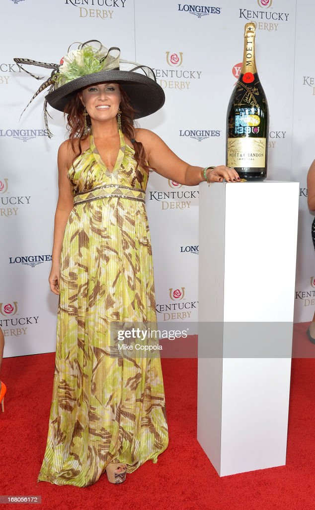 Jo Dee Messina signs the Moet & Chandon 6L for the Churchill Downs Foundation during the 139th Kentucky Derby at Churchill Downs on May 4, 2013 in Louisville, Kentucky.