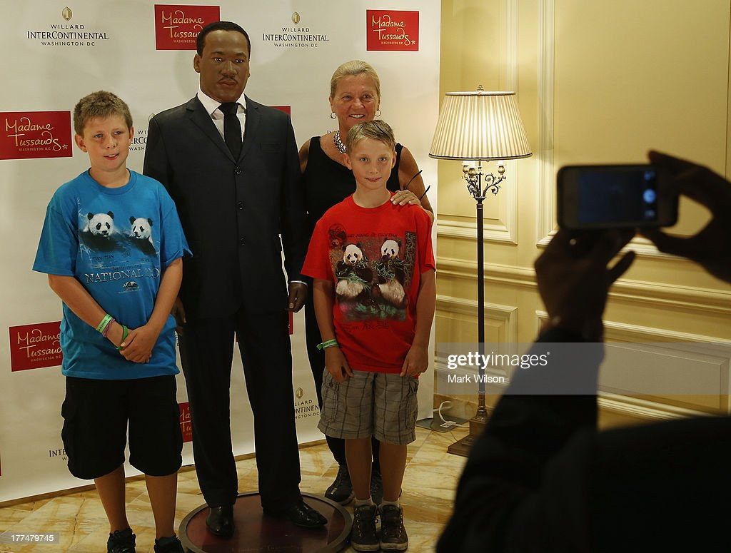 Jo Ellen Ashby (R) and her grandsons Mason (L) and Hudson have their picture taken next to a wax figure of Rev. Martin Luther King Jr. is on display at the Willard Intercontinental Hotel August 23, 2013 in Washington, DC. The wax figure is on loan from Madame Tussauds to help commemorate the 50th anniversary of the March on Washington.