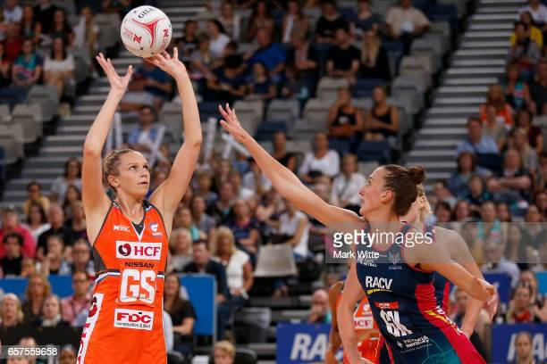 Jo Harten of Giants Netball shoots over Emily Mannix of Melbourne Vixens during the round six Super Netball match between the Vixens and the Giants...