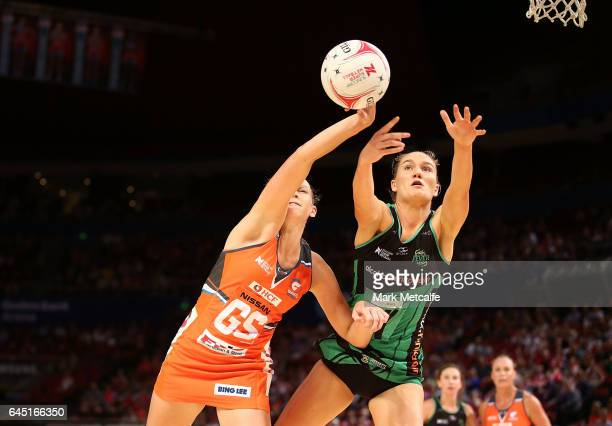 Jo Harten of the Giants and Courtney Bruce of the Fever contest possession during the round two Super Netball match between the Giants and the West...