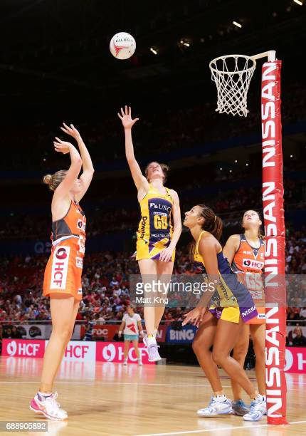 Jo Harten of the Giants is challenged by as Karla Mostert of the Lightning defends during the round 14 Super Netball match between the Giants and the...