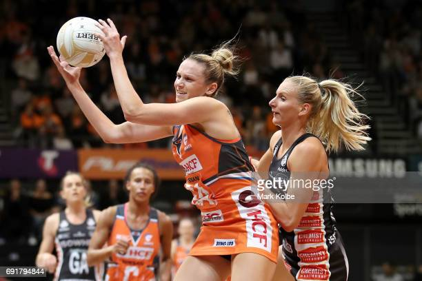 Jo Harten of the Giants wins the ball under pressure from April Brandley of the Magpies during the Super Netball Major Semi Final match between the...