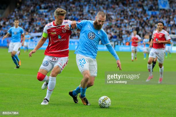 Jo Inge Berget of Malmo FF and Viktor Elm of Kalmar FF during the Allsvenskan match between Malmo FF and Kalmar FF at Swedbank Stadion on August 11...