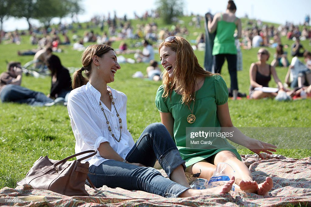 Jo Israelson and Olivia Lee laugh together as they enjoy the hot weather in Primrose Hill on April 15, 2007 in London, England. The un-seasonably warm weather has heralded the start to what weather forecasters predict will be a record breaking summer.