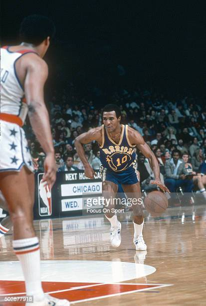 Jo Jo White of the Golden State Warriors dribbles the ball against the Washington Bullets during an NBA basketball game circa 1979 at the Capital...