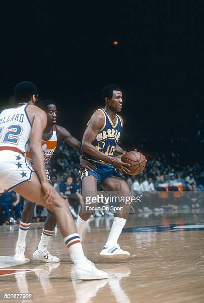 Jo Jo White of the Golden State Warriors looks to pass the ball against the Washington Bullets during an NBA basketball game circa 1979 at the...