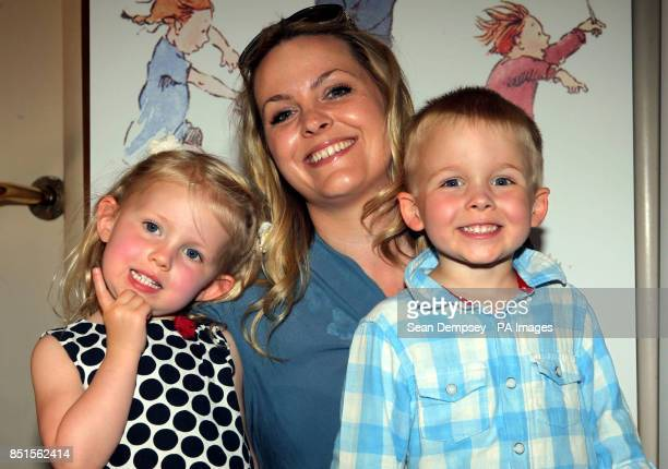 Jo Joyner and twins Edie Fred aged threeandahalf attending a special performance show of We're Going On A Bear Hunt at the Lyric Theatre