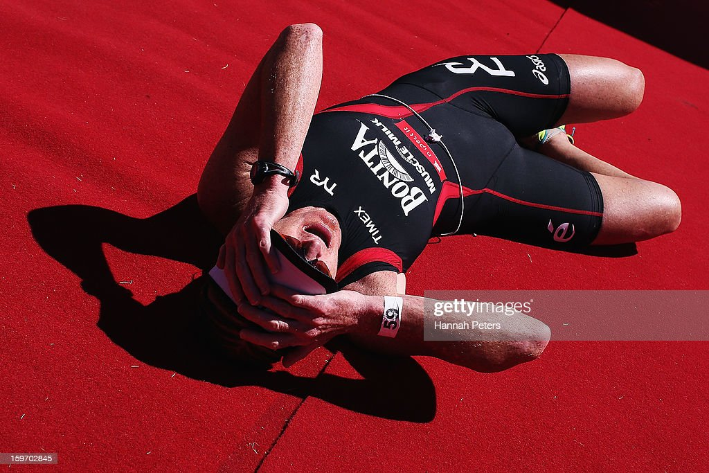 Jo Lawn of Auckland collapses after finishing third in the Challenge Wanaka on January 19, 2013 in Wanaka, New Zealand.