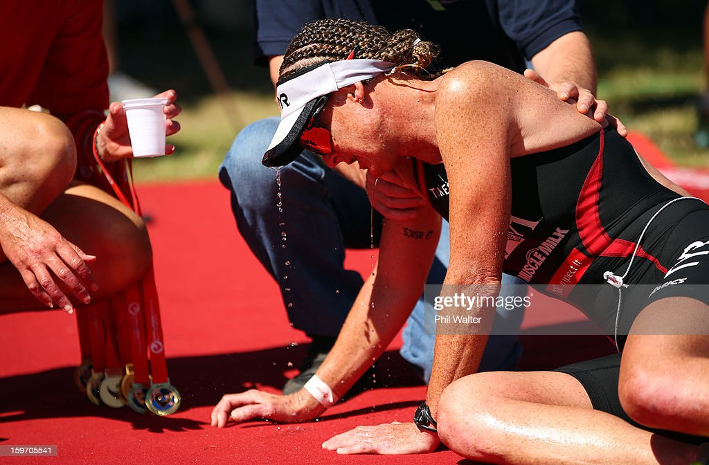 Jo Lawn of New Zealand collapses on the finish line after competeing in the Challenge Wanaka on January 19, 2013 in Wanaka, New Zealand.