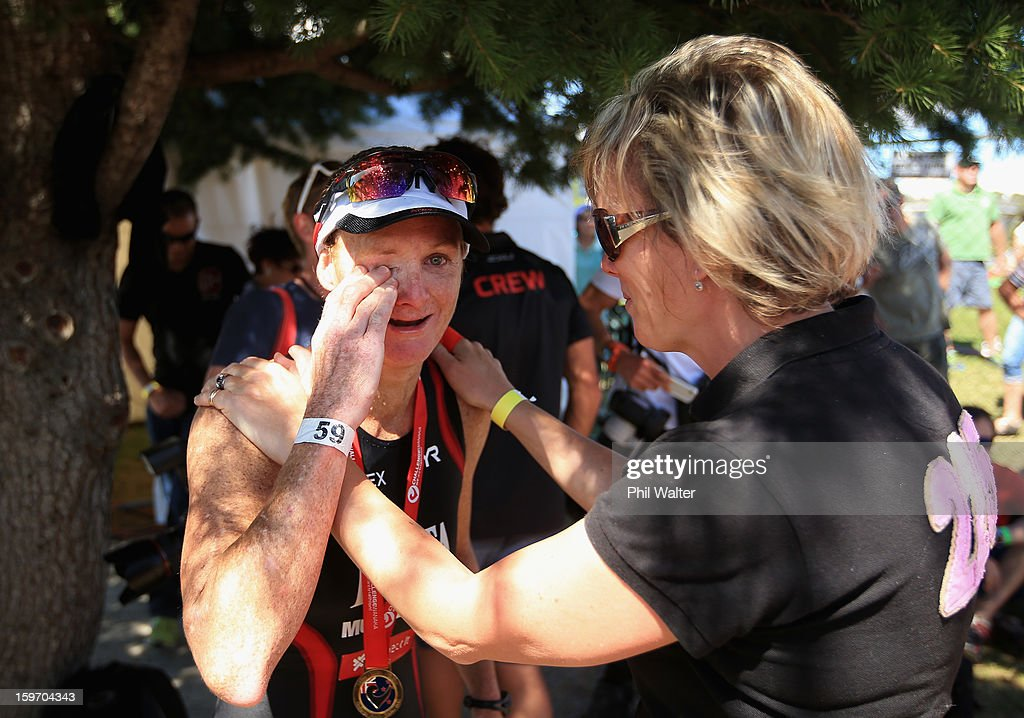 Jo Lawn of New Zealand (L) is congratulated by race director Victoria Murray-Orr (R) after crossing the finish line in the Challenge Wanaka on January 19, 2013 in Wanaka, New Zealand.