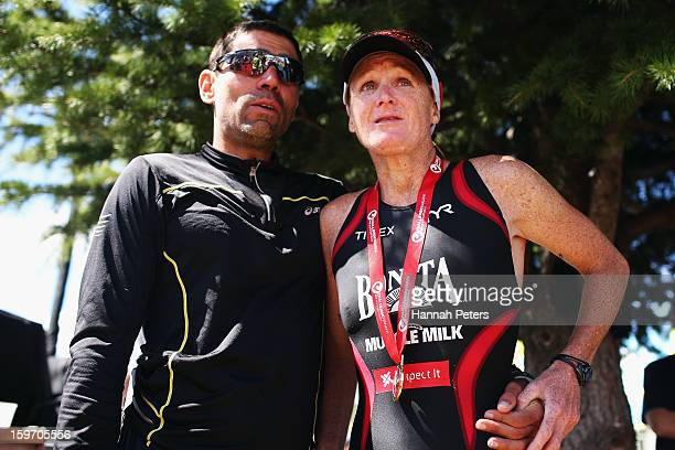 Jo Lawn of New Zealand is supported by her husband Armando Galarraga after finishing third during Challenge Wanaka on January 19 2013 in Wanaka New...