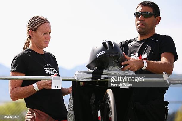 Jo Lawn of New Zealand sets up her bike with husband Armando Galarraga prior to the Challenge Wanaka on January 18 2013 in Wanaka New Zealand