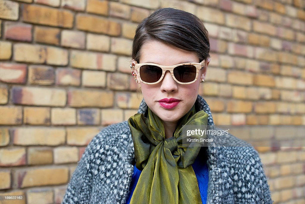Jo Lees social media manager for Finlay and Co wearing an H and M jacket, vintage scarf and top, Finay and Co glasses and an Asos Ear cuff on day 3 of London Mens Fashion Week Autumn/Winter 2013, on January 09, 2013 in London, England.
