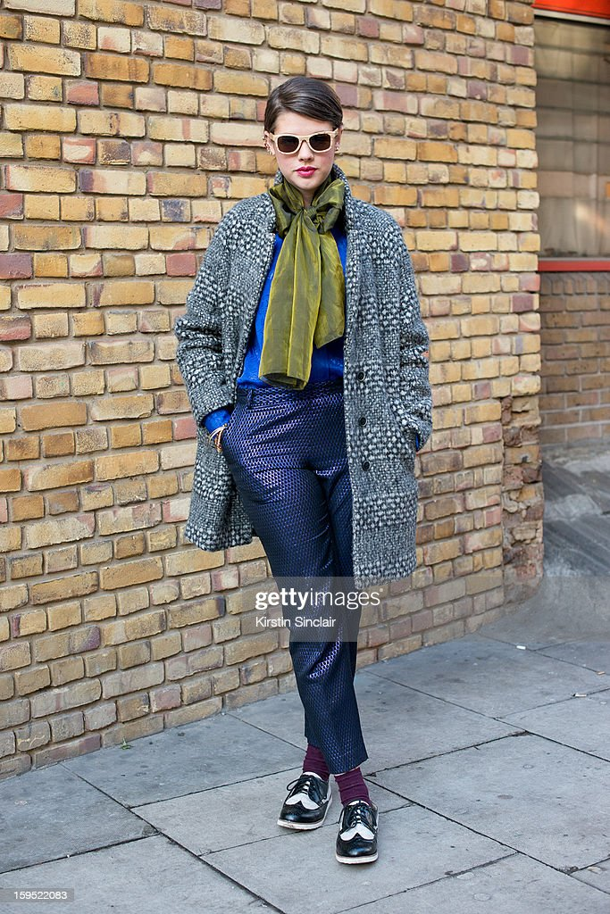 Jo Lees social media manager for Finlay and Co wearing H and M kids shoes, H and M trousers and jacket, vintage scarf and top, Finay and Co glasses and an Asos Ear cuff on day 3 of London Mens Fashion Week Autumn/Winter 2013, on January 09, 2013 in London, England.