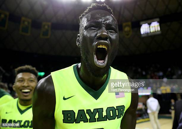 Jo LualAcuil Jr #0 of the Baylor Bears celebrates after beating the Iowa State Cyclones 6563 at Ferrell Center on January 4 2017 in Waco Texas