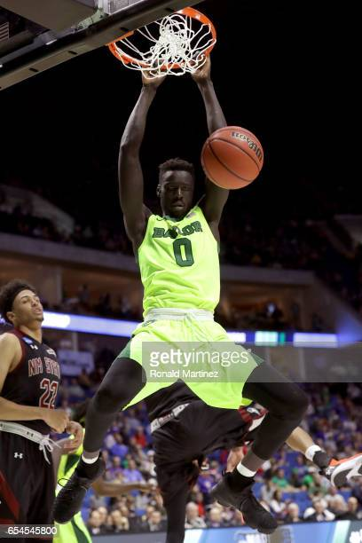 Jo LualAcuil Jr #0 of the Baylor Bears dunks in the second half against the New Mexico State Aggies during the first round of the 2017 NCAA Men's...