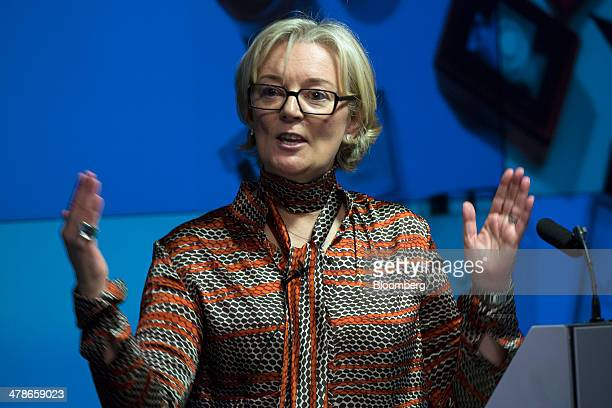 Jo Malone founder of Jo Loves the luxury retailer of fragrances perfumes and candles gestures during a 'Women in Business' event in London UK on...