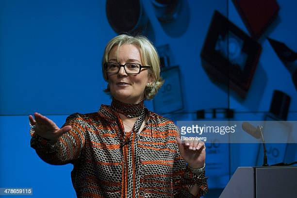 Jo Malone founder of Jo Loves the luxury retailer of fragrances perfumes and candles gestures as she speaks during a 'Women in Business' event in...