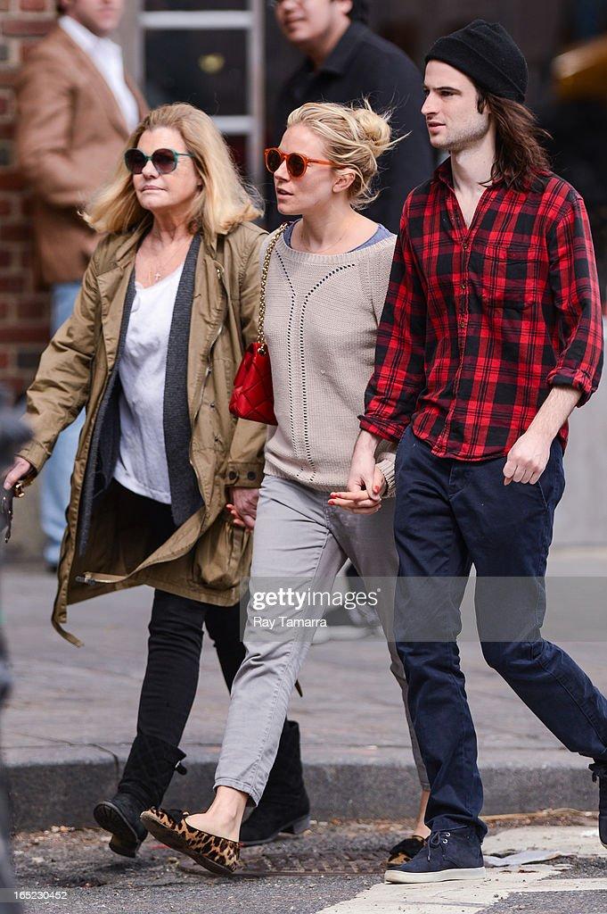 Jo Miller, Sienna Miller, and Tom Sturridge walk in the West Village on April 1, 2013 in New York City.