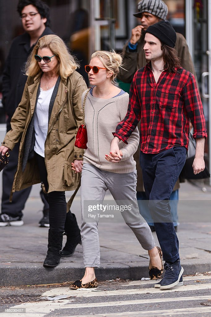 Jo Miller, <a gi-track='captionPersonalityLinkClicked' href=/galleries/search?phrase=Sienna+Miller&family=editorial&specificpeople=171883 ng-click='$event.stopPropagation()'>Sienna Miller</a>, and <a gi-track='captionPersonalityLinkClicked' href=/galleries/search?phrase=Tom+Sturridge&family=editorial&specificpeople=2666406 ng-click='$event.stopPropagation()'>Tom Sturridge</a> walk in the West Village on April 1, 2013 in New York City.