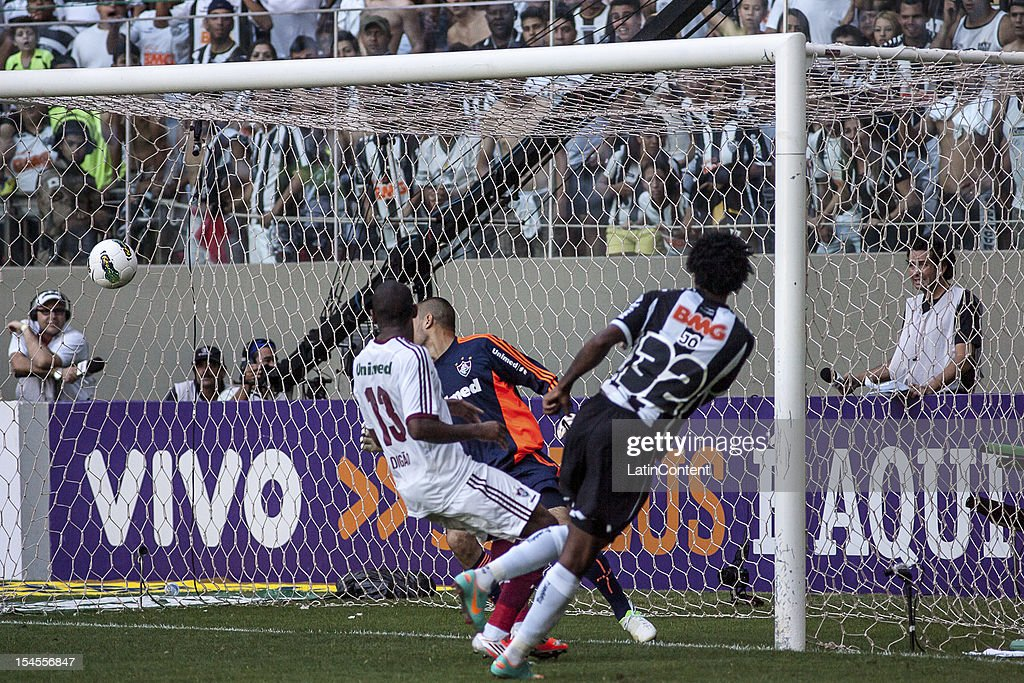 Jo of Atletico MG celebrates a goal during a match between Atlético MG and Fluminense as part of Campeonato Brasileiro 2012 at Estádio Independência...