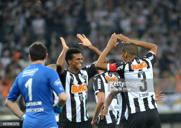Jo of Atletico Mineiro celebrates a goal with teammate Lucas Silva during a match between Atletico during a match between Atletico Mineiro and Lanús...