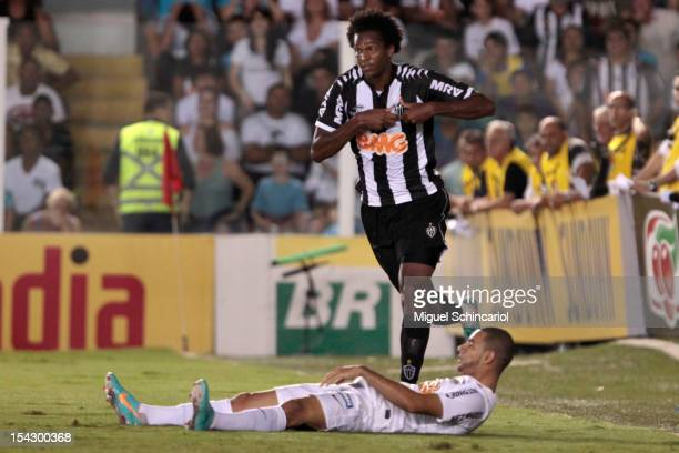 Jo of Atletico Mineiro celebrates a scored goal against Santos during a match between Santos and Atletico Mineiro as part of the Brazilian...