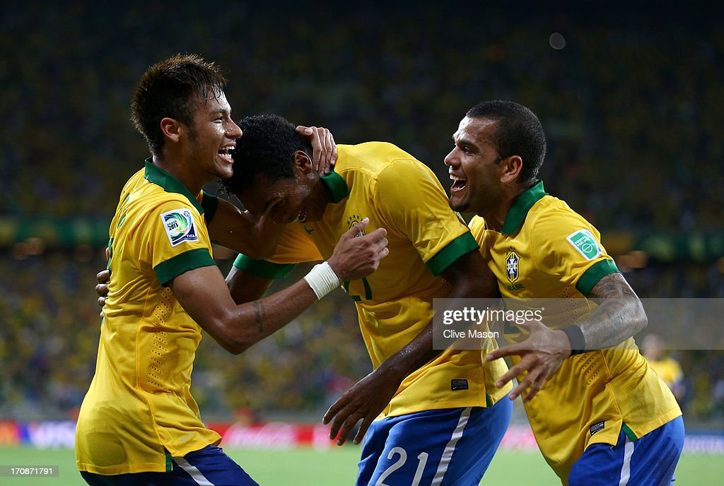 Jo of Brazil celebrates scoring his team's second goal with team-mates Neymar (L) and Daniel Alves (R) during the FIFA Confederations Cup Brazil 2013 Group A match between Brazil and Mexico at Castelao on June 19, 2013 in Fortaleza, Brazil.